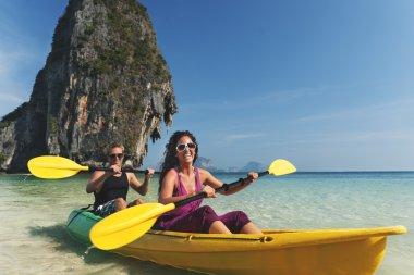 Cople Kayaking in the sea