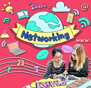girls browsing digital tablet