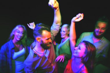 friends dancing at night party
