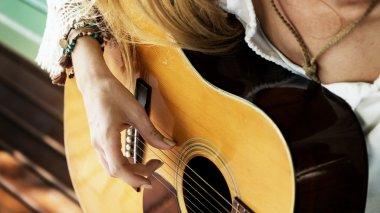 girl playing on guitar
