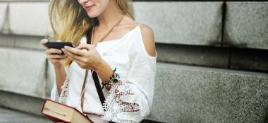 Woman holding smart phone in hands
