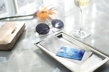 Credit  Card and bill on table.