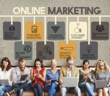 people sit with devices and Online Marketing