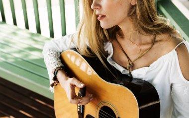 Cute Girl playing on Guitar