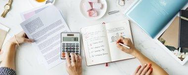 Women Calculating Business Plan