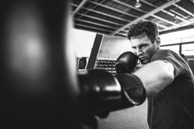 Athletic Man training Boxing