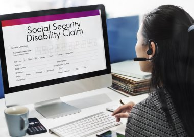 businesswoman working on computer with Social Security