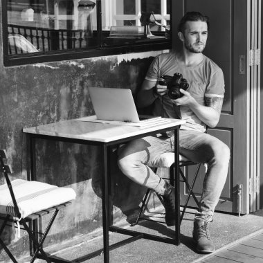 Man with Camera in street