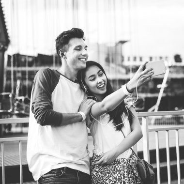 Couple making selfie in amusement park