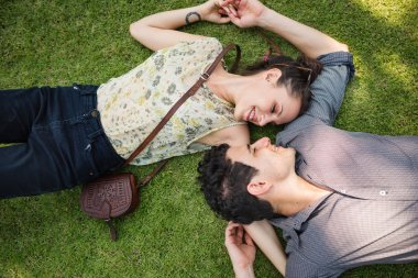 Sweet Couple Laying on Grass