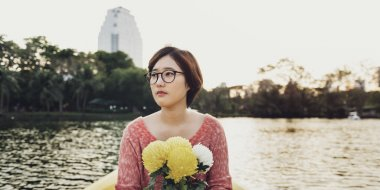 Asian woman holding flowers