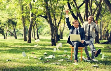 Businessman and Businesswoman with laptop at park