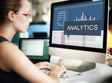 businesswoman working on computer with Analytics