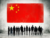 Business People In front Of Flag Of China