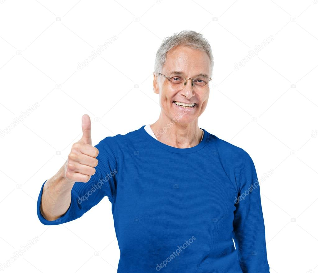 mature adult showing thumbs up — stock photo © rawpixel #52450271