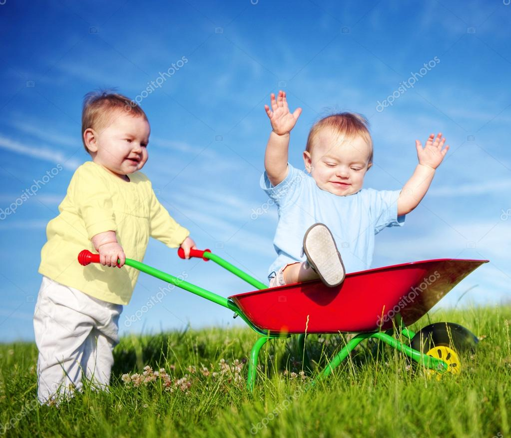 Two toddlers playing outdoors