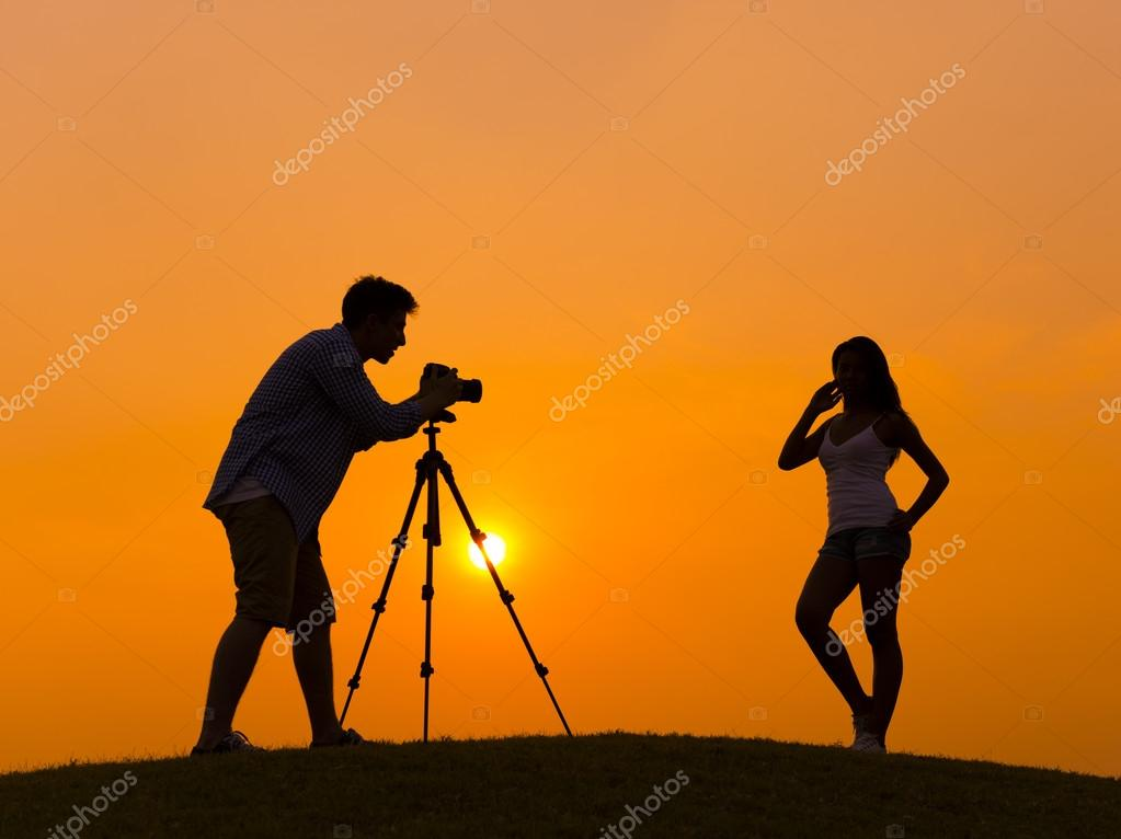 Photographer taking picture of model
