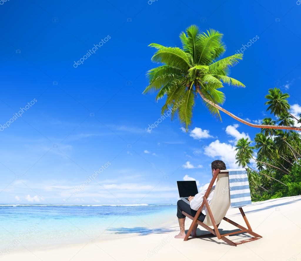 Businesman working at beach