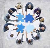 Fotografie Business People and Jigsaw Puzzle Pieces