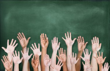 Hands Raised with Blackboard