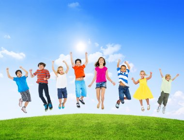 Group of Children Jumping Outdoors