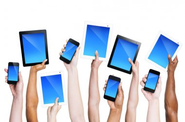 Hands holding smartphones and tablets