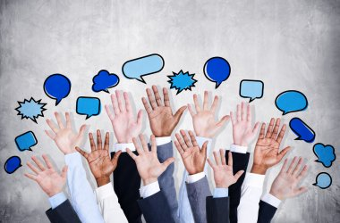 Business arms raised with speech bubbles