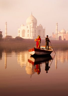 Indian man and woman on boat