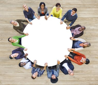 People Forming Circle Holding Hands
