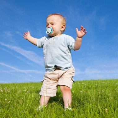 Baby lost in grassland