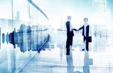 Two Business People Having Handshake