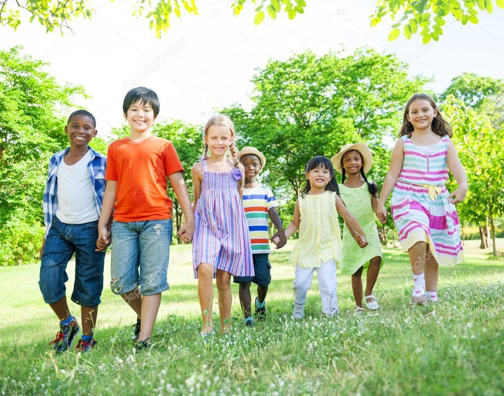 Children walking In Park