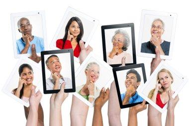 Hands holding digital tablets