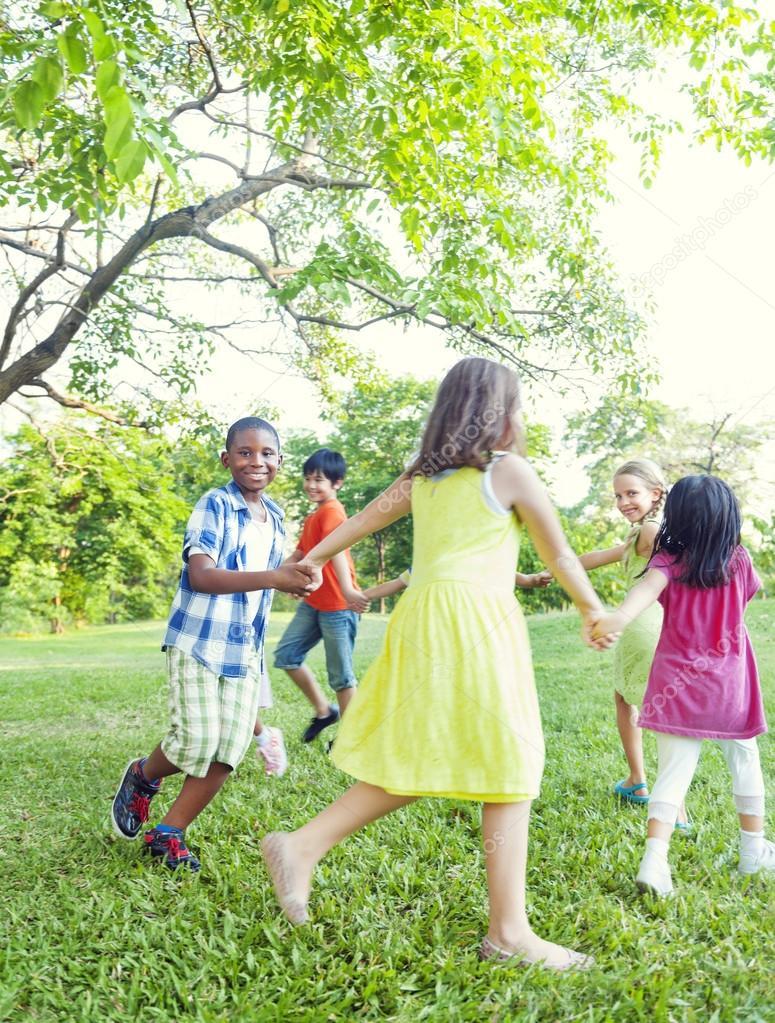 Children dancing in park