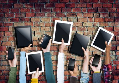 Hands Holding Digital Tablets and Mobile Phones