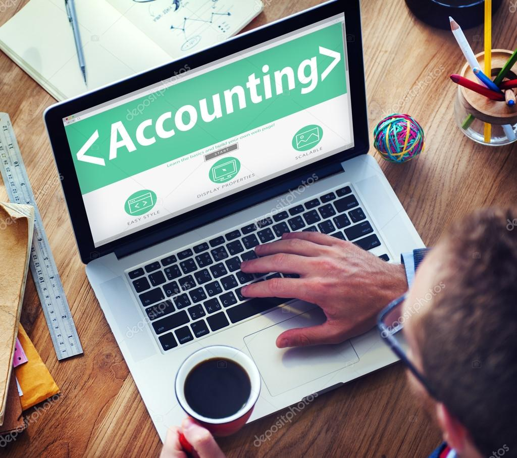 Businessman at laptop with accounting Concept