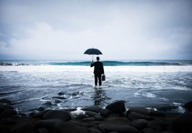 Lonely Businessman Alone in Beach