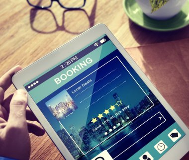 Man Booking Hotel Reservation on Tablet