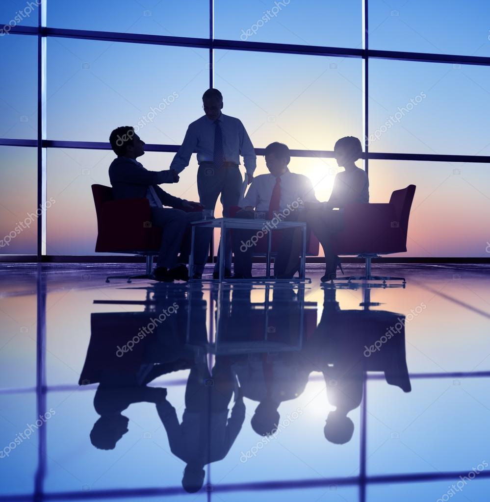 Business People Meeting in Back Lit