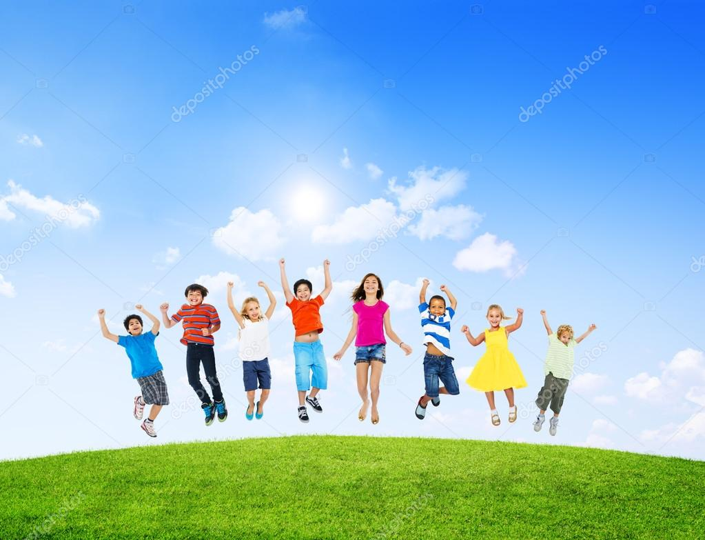 Multi-Ethinc Children Jumping Outdoors