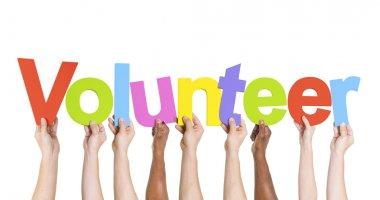 Hands Holding The Word Volunteer