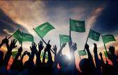 Fotografie People Holding Flags of Saudi Arabia