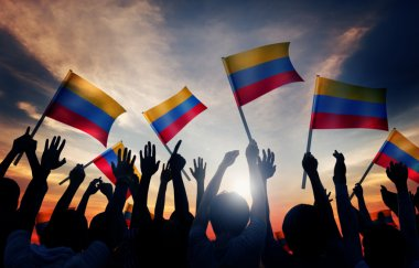 People Holding Flags of Colombia