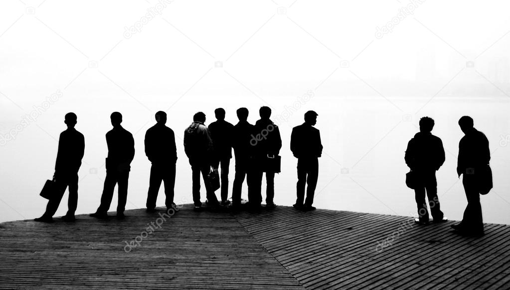 Black silhouettes of men