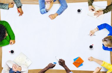 Teamwork of Multiethnic People in a Meeting