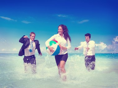 Business People in the water on the beach