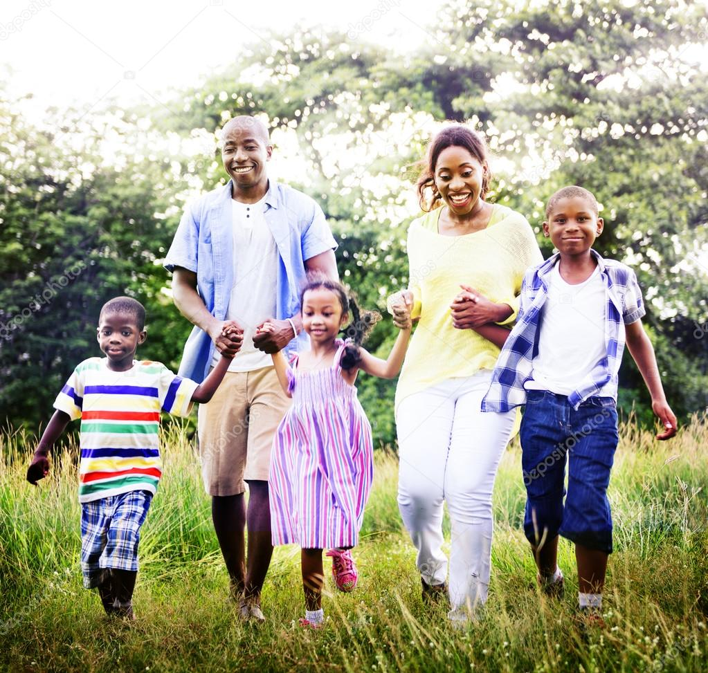 African American family relaxes on the nature