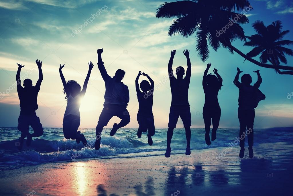 Young People Jumping on the Beach