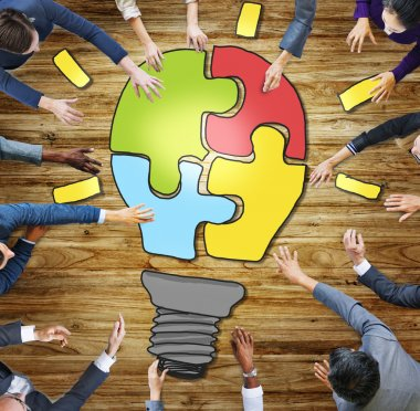 Business People and  Light Bulb Innovation Concepts