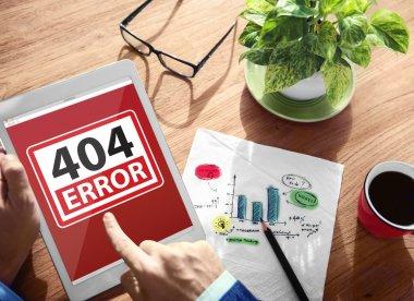 Man Using a Digital Tablet with 404 Error